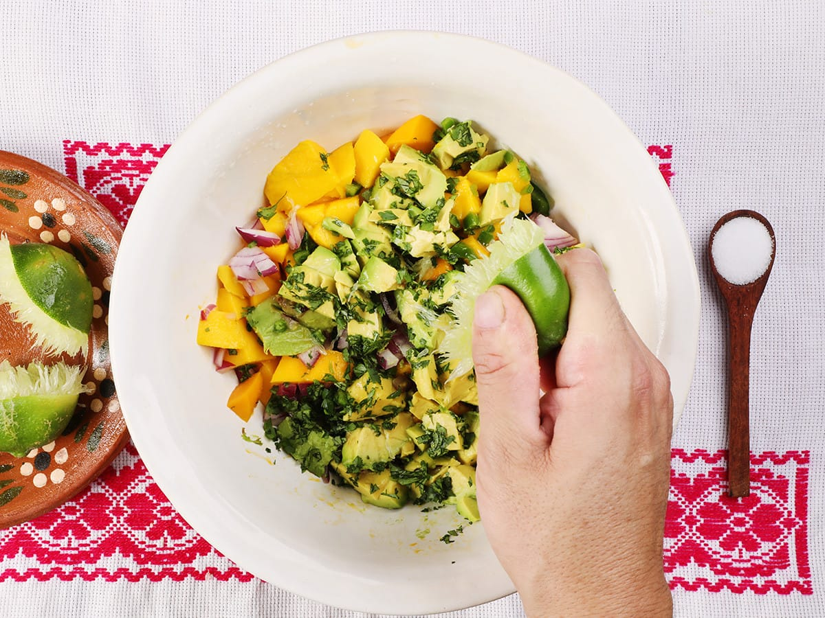 Squeezing Lime on Mango Salsa