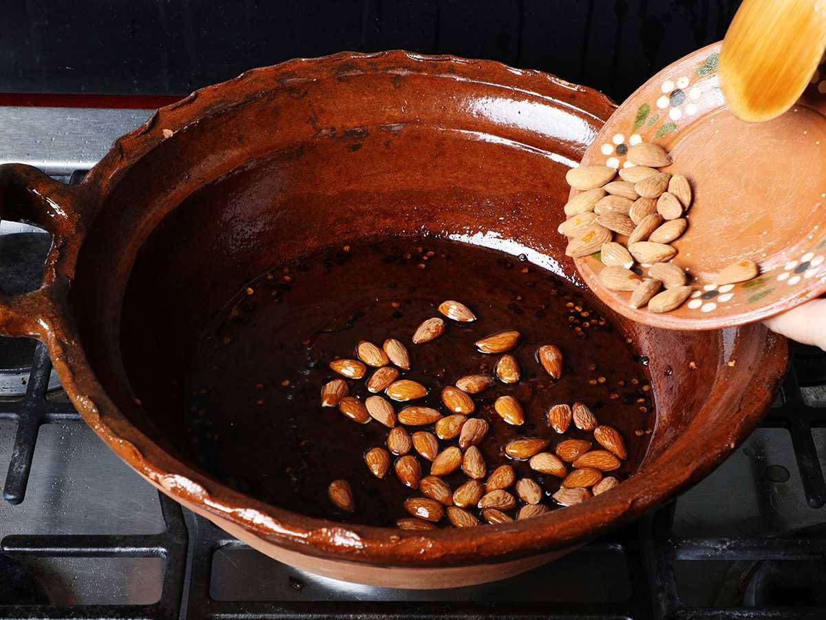 Frying Almonds in Clay Pot