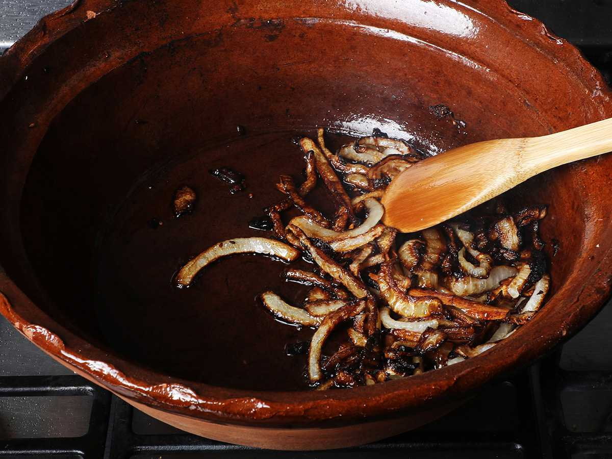 Frying Onions in Clay Pot