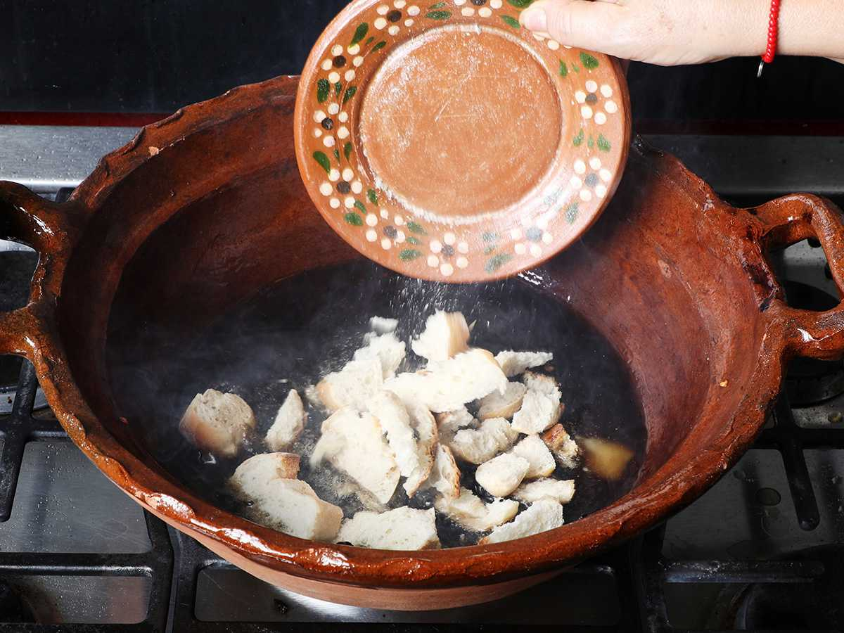 Pouring Bread into Mole Pot