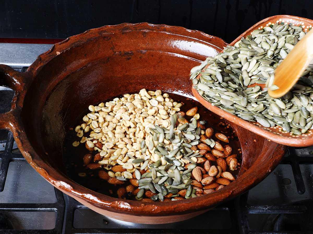 Pouring Pumpkin Seeds into Pot