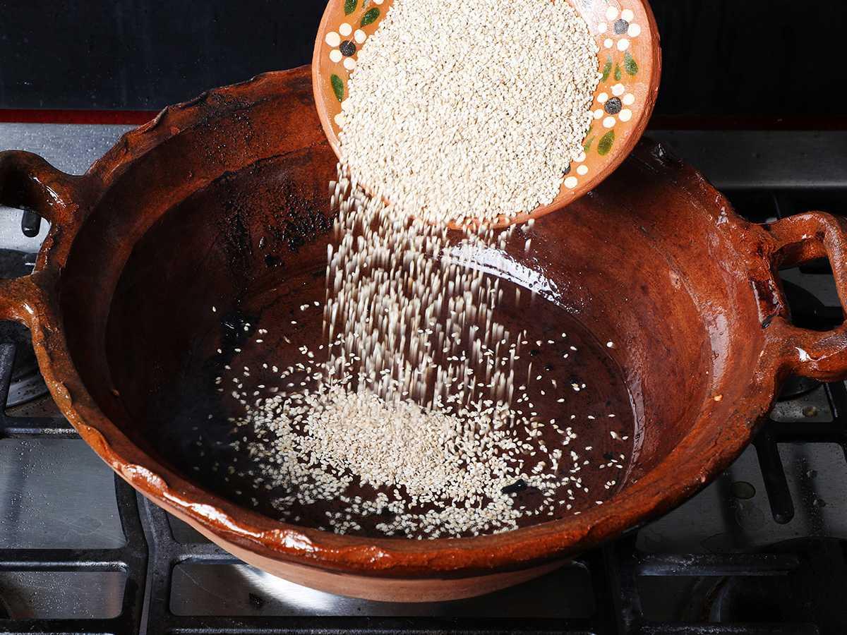 Pouring Sesame Seeds into Pot