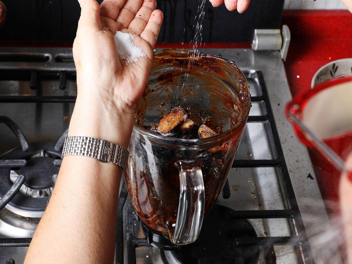 Sprinkling Salt into Blender with Mole