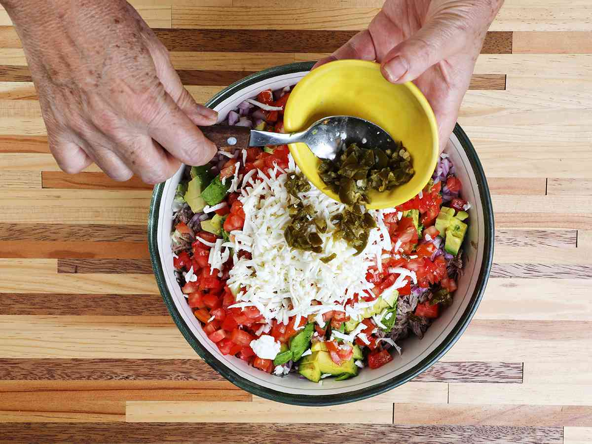 Adding Pickled Chilis to Salpicon