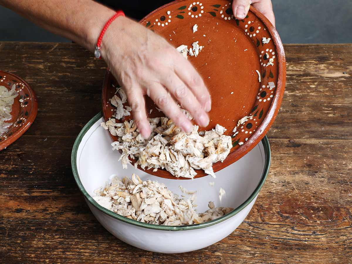 Pouring Shredded Chicken into Bowl