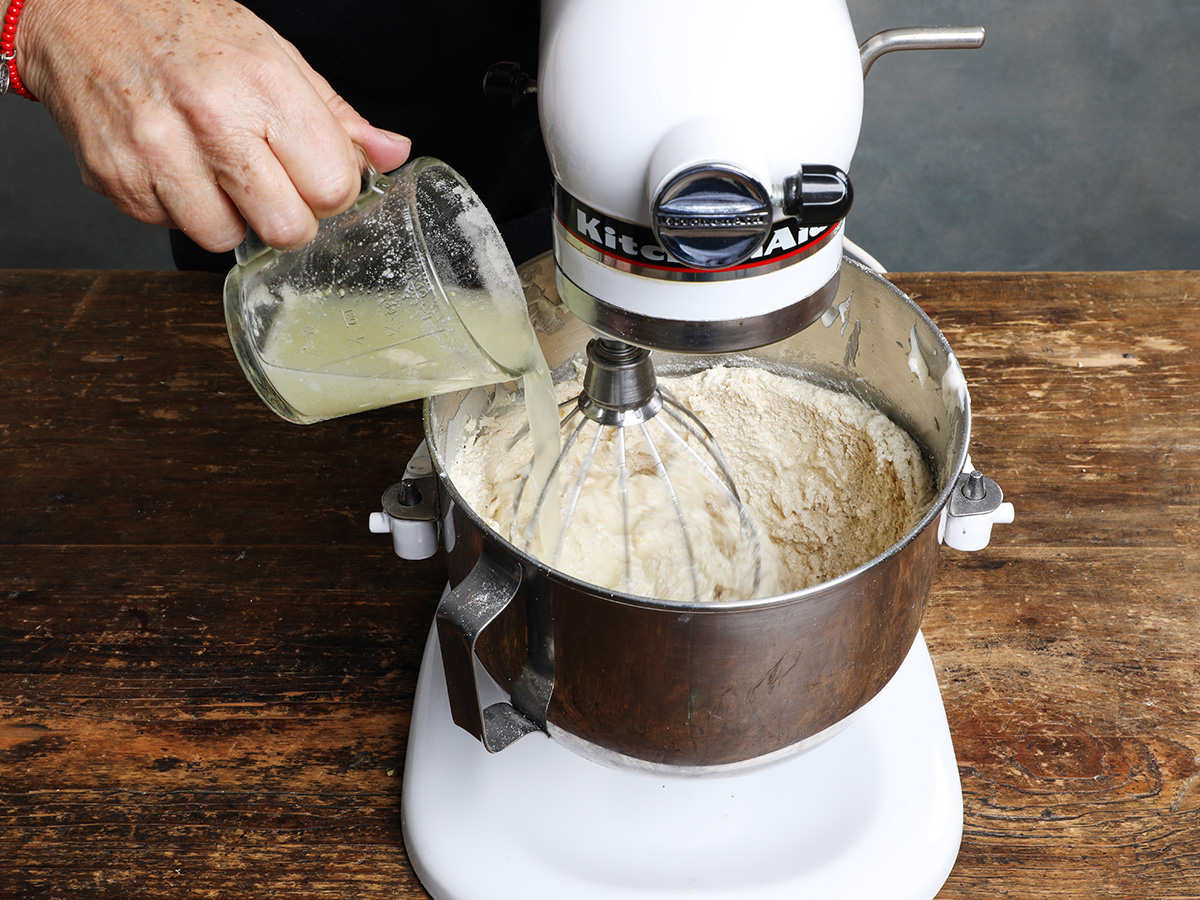 Pouring Vegetable Broth into Masa