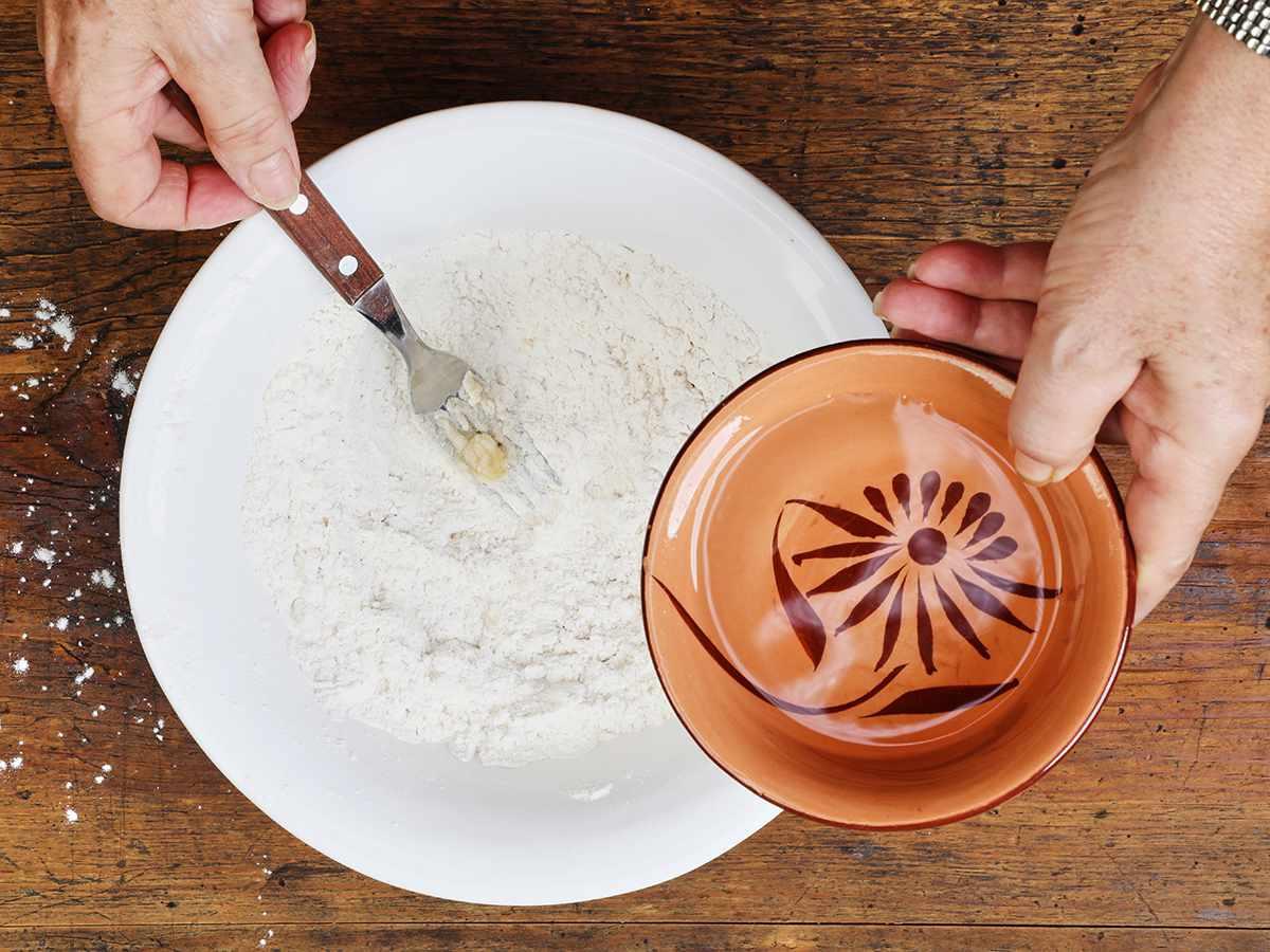 Adding Water to Buñuelo Dough